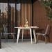 Modloft Amsterdam Round Modern Outdoor Dining Table in White Sand Concrete with White Steel Base - Lifestyle Side View