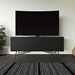 BDI Sector Modern Media Console in Sepia Laminate with Black Powder Coated Steel Base - Room Setting with TV